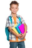 Boy with books Stock Images