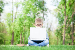 Boy with a books and laptop computer Stock Image