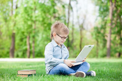 Boy with a books and laptop computer Royalty Free Stock Images