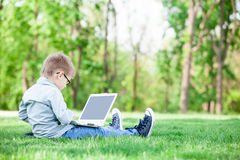 Boy with a books and laptop computer Stock Images