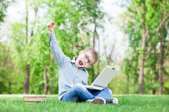 Boy with a books and laptop computer Royalty Free Stock Photography