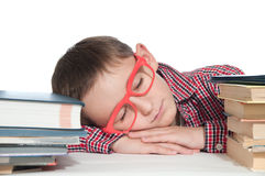 Boy with books sleeping on the table Stock Photos