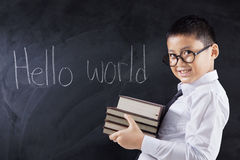 Boy with books and text Hello World Stock Photography