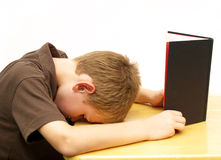 Boy bored with homework Royalty Free Stock Photography