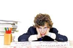 Boy bored at school Royalty Free Stock Image