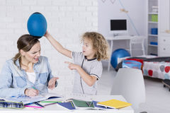 Boy bothering his mother Royalty Free Stock Images