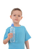 Boy and bottle of water Royalty Free Stock Image