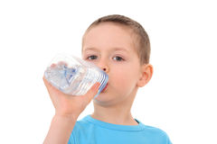 Boy and bottle of water Stock Photography