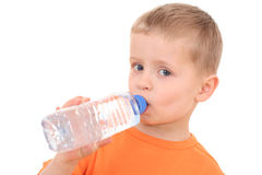 Boy and bottle of water Stock Image
