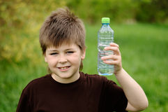 Boy with a bottle of water in nature Stock Photos