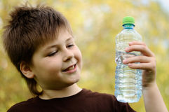 Boy with a bottle of water in nature Stock Photo