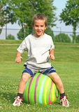 Boy Bouncing on a Ball. Boy outside laughing bouncing on a Ball stock photos