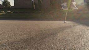 Boy bouncing on a pogo stick. Slow motion shot of a boy bouncing on a pogo stick stock footage