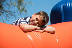 Boy on a bouncy a bouncy castle. Little eboy is climbing on a bouncy castle Stock Photography