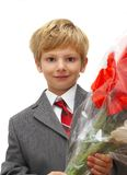The boy with a bouquet royalty free stock photography