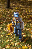 Boy with bouquet of autumn flowers Royalty Free Stock Images