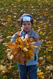 Boy with bouquet of autumn flowers Stock Photo