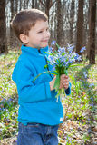 Boy with bouquet of bluebells Royalty Free Stock Photo
