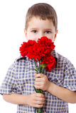 Boy with bouquet of carnations Royalty Free Stock Image