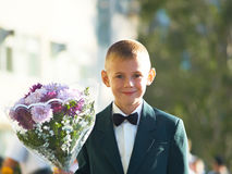 The boy with a bouquet of colors Stock Photography