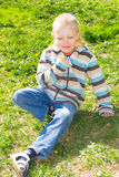 Boy with a bouquet of dandelions Royalty Free Stock Images