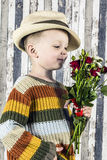 A boy and a bouquet Royalty Free Stock Images