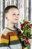 A boy and a bouquet Royalty Free Stock Photo