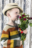 A boy and a bouquet Royalty Free Stock Image