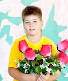 Boy with  bouquet of roses Stock Images