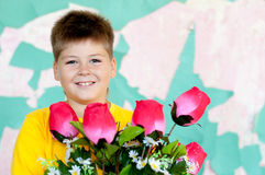 Boy with  bouquet of roses Royalty Free Stock Photography