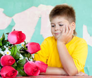 Boy with  bouquet of roses Royalty Free Stock Photos