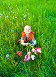 The boy with a bouquet of tulips Stock Image