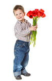 Boy with bouquet of tulips Royalty Free Stock Photography