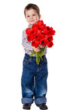 Boy with bouquet of tulips Royalty Free Stock Image