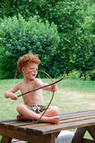 Boy with Bow and Arrow stock photography