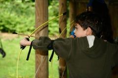 Boy with bow and arrow Stock Photos