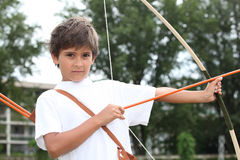 Boy with bow and arrow Royalty Free Stock Photography