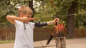 Boy with a bow and arrow. Bowman background. royalty free stock images