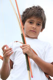 Boy with bow and arrow Stock Photo