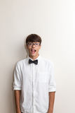 Boy with bow tie jokes Royalty Free Stock Image