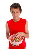 Boy with a bowl of candied popcorn Stock Image