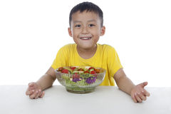 Boy with a bowl of fruit salad Royalty Free Stock Images
