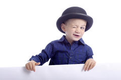 Boy with bowler hat making a wink Stock Images