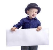 Boy with bowler hat making a wink Royalty Free Stock Photo
