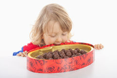 Boy with box of chocolate Royalty Free Stock Images