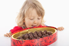 Boy with box of chocolate Stock Image
