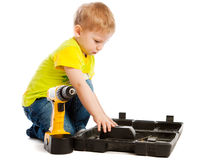 Boy, box and screwdriver Royalty Free Stock Images