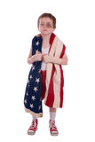 Boy boxer. Young boy boxer preparing for a fight wrapped in the american flag Stock Photography