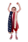 Boy boxer. Young boy boxer preparing for a fight wrapped in the american flag Stock Photos