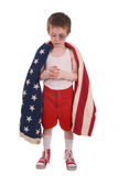 Boy boxer. Young boy boxer preparing for a fight wrapped in the american flag Stock Images